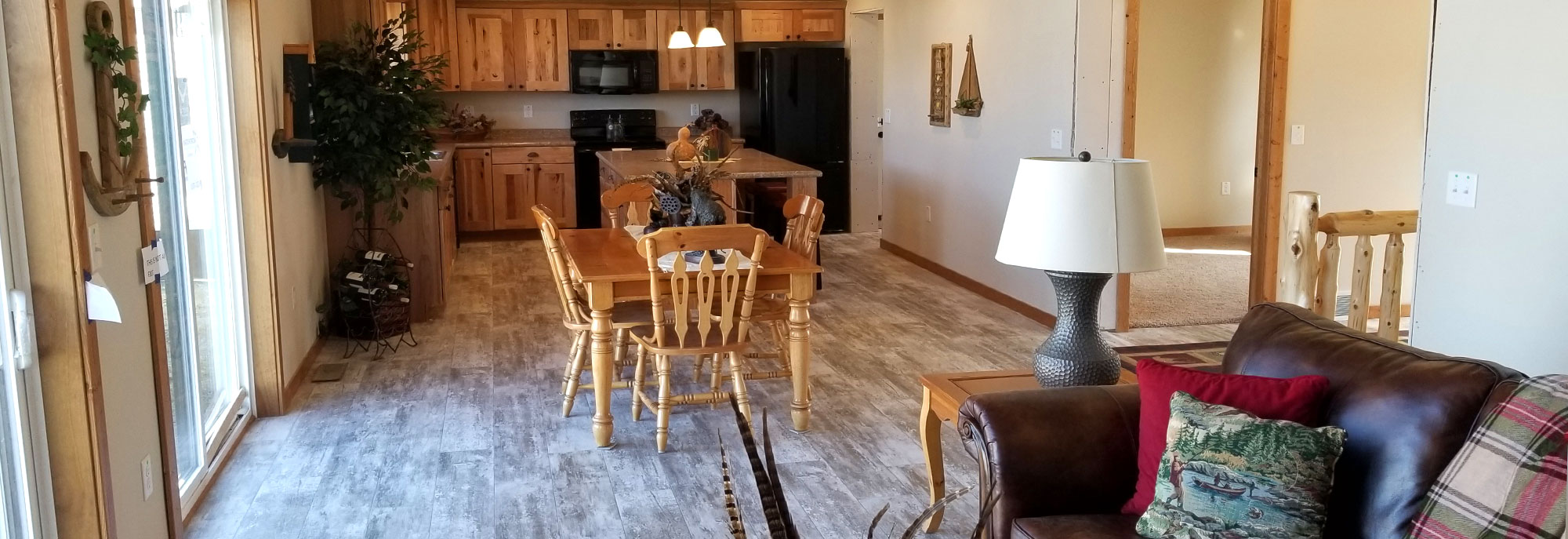 The kitchen, living and dining open concept of the Hudson Model Modular Home built by Factory Home Center