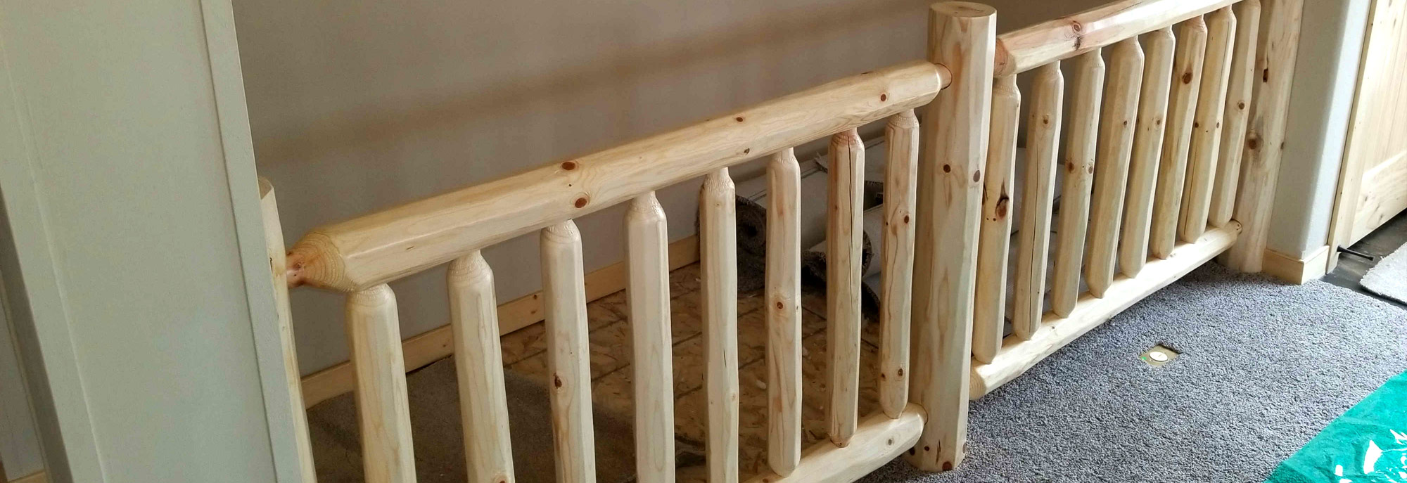 The pine stair railing of the Spicer Model Modular Home built by Factory Home Center